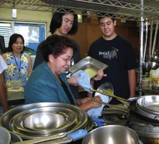 Galera trains the students in a Hawaii high school home economics class on the basics of cleaning and sanitation in the kitchen.